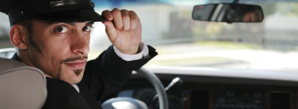 Limo Service - Chauffeur Saluting a Passanger
